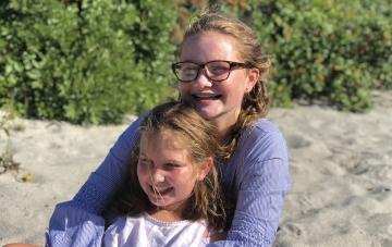 Sisters Emma and Sarah at the beach