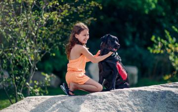 Jillian Galvin, a patient at Joslin and her diabetes alert dog Eppie.