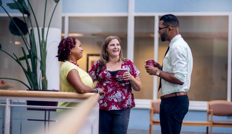 Three Joslin staff members talking in the Joslin atrium