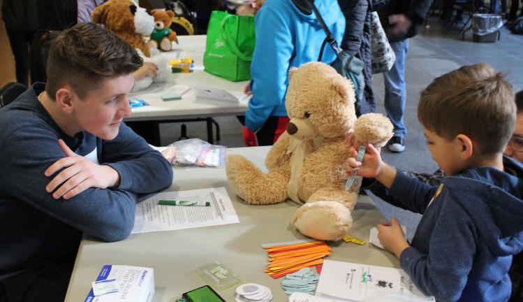 Young boy at Joslin's teddy bear clinic.