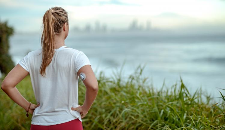 Young woman with diabetes ready for morning run along the coast