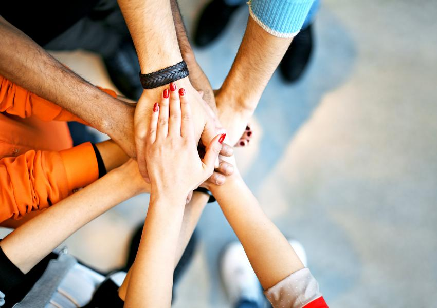 Group of hands showing unity and teamwork