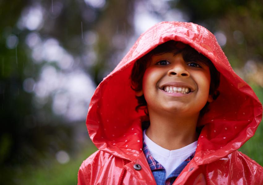 Joyful boy in rain