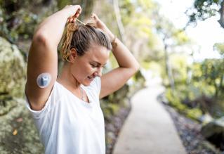 Diabetic young woman preparing for a run